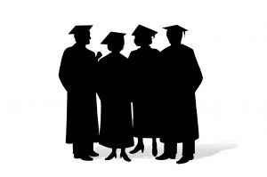 silhouette of 4 graduates in caps and gowns